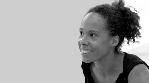 A black and white image showing the face of Patricia Okenwa, image by Chris Nash