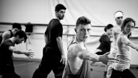 A black and white image of choreographer James Cousins in class. Image by Josefina Pérez