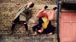 aKa Dance Theatre image: female and male performers are against a brick wall